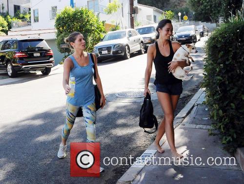 Ashley Greene and Cara Santana at home