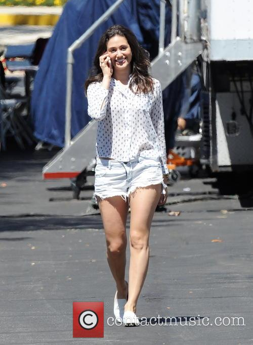 Emmy Rossum sports daisy duke shorts while filming...
