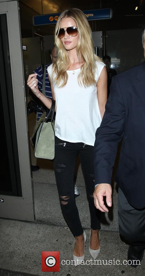 Rosie Huntington-Whiteley arrives at Los Angeles International (LAX)...