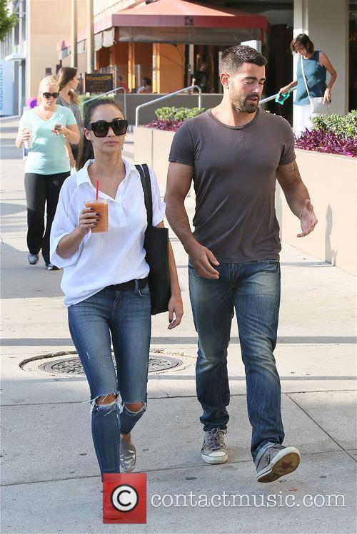 Jesse Metcalfe and girlfriend Cara Santana leave the...
