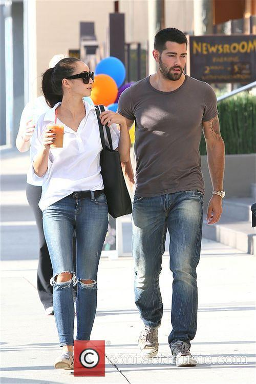 Jesse Metcalfe and girlfriend Cara Santana leave the...
