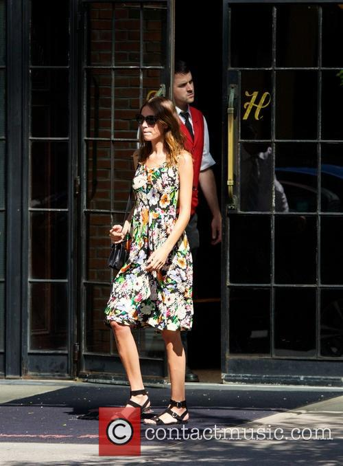 Alexa Chung seen wearing a floral dress in...