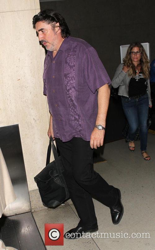 Alfred Molina arrives at Los Angeles International (LAX)...