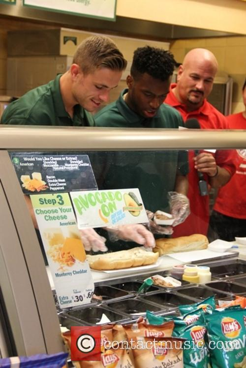 Liverpool Players Serving Sandwiches at Subways