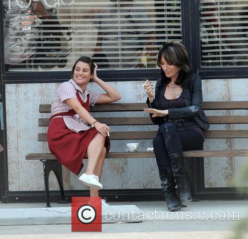 Lea Michele is seen wearing a waitress outfit...