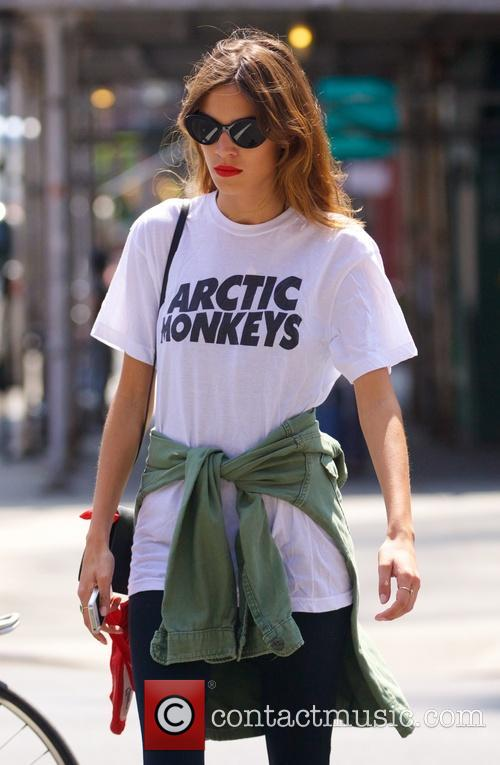 Alexa Chung looking casual in an Arctic Monkeys...