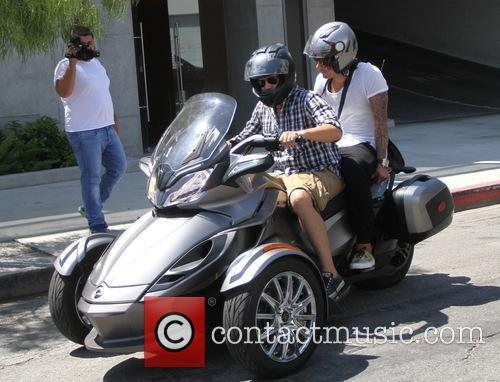 Jermaine Jones with a friend goes for a...