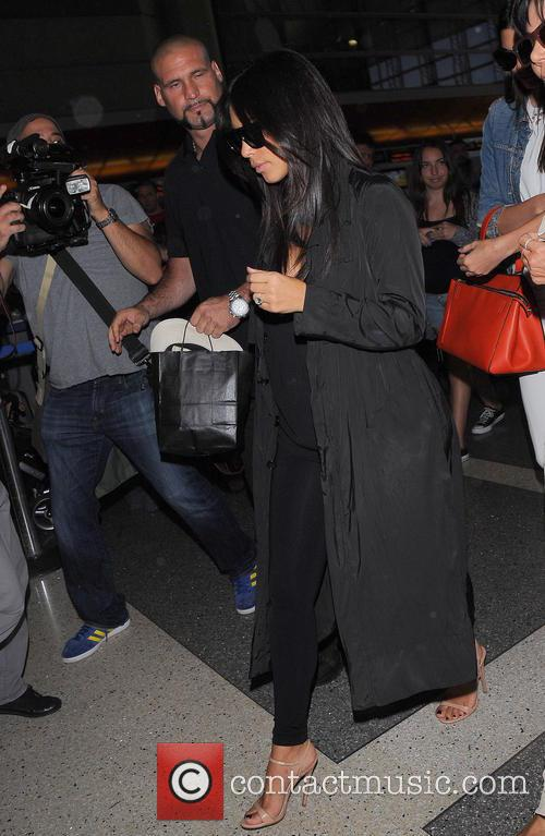 Kendall Jenner, Kris Jenner and Kim Kardashian at Los Angeles International Airport (LAX)