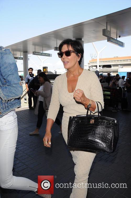 Kendall Jenner, Kris Jenner and Kim Kardashian at Los Angeles International Airport (LAX)