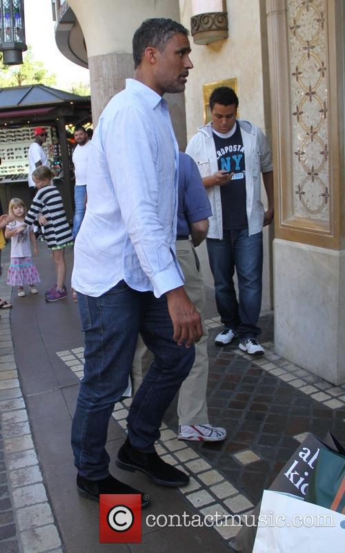 Retired professional basketball player Rick Fox takes his...