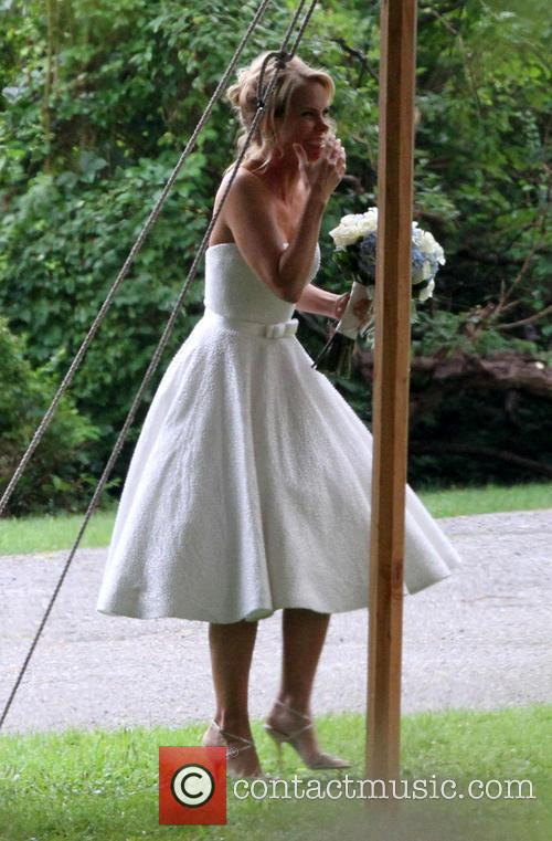 Cheryl Hines, wearing her wedding dress, is emotional...