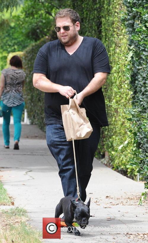 Jonah Hill walks his dog