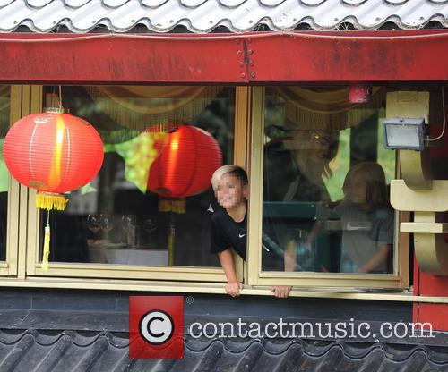 Gwen Stefani and her family enjoy dinner at...