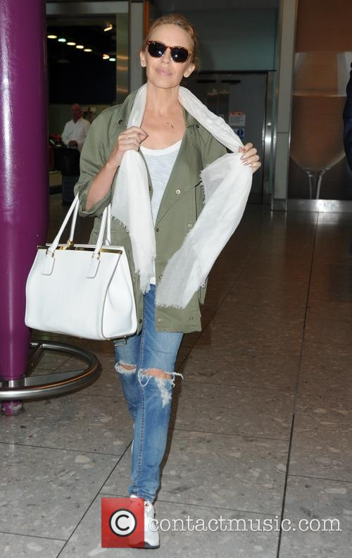 Kylie Minogue arrives at Heathrow airport