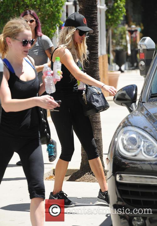 Ashlee Simpson finishes a workout