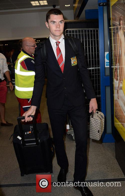 Manchester United Players arrive at Manchester Airport
