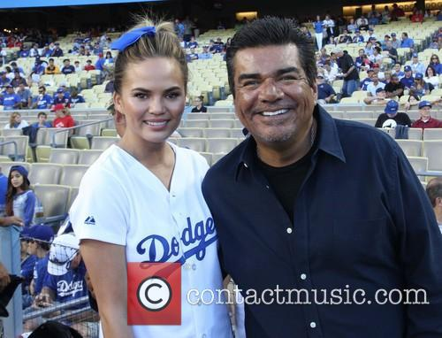 Chrissy Teigen and George Lopez 5