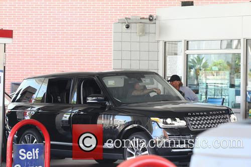 David Beckham drives his black Range Rover