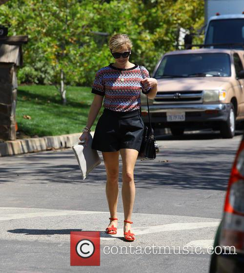 Reese Witherspoon goes to visit her new home...