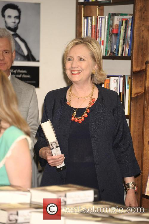 Hillary Clinton signs copies of her new book...