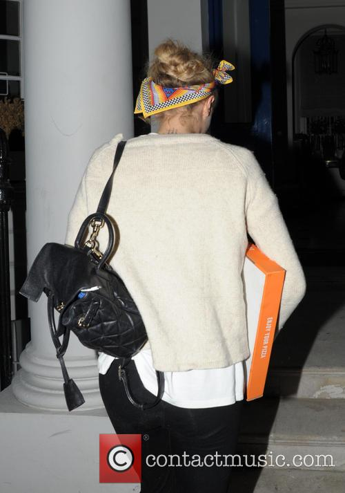 Cara Delevingne returning home with a pizza