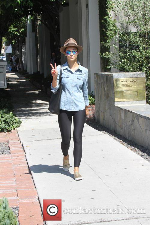 Cara Santana out and about in mirror sunglasses