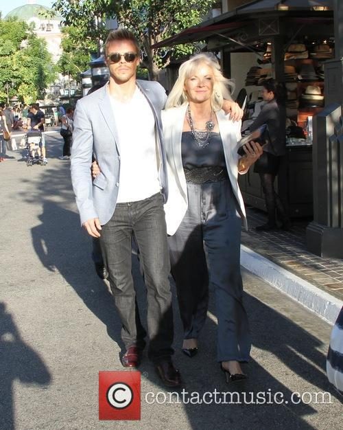 Derek Hough takes his mother to his book...