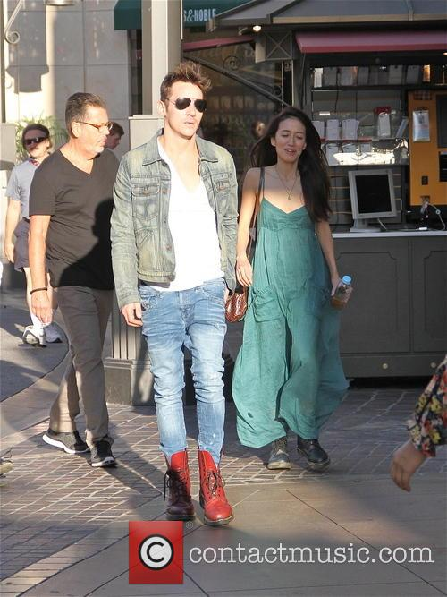 Jonathan Rhys Meyers goes shopping with a female companion