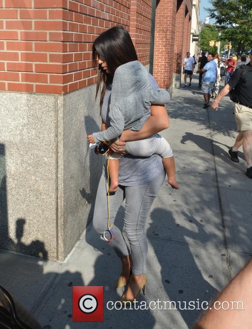 Kim Kardashian arriving at her apartment in Manhattan