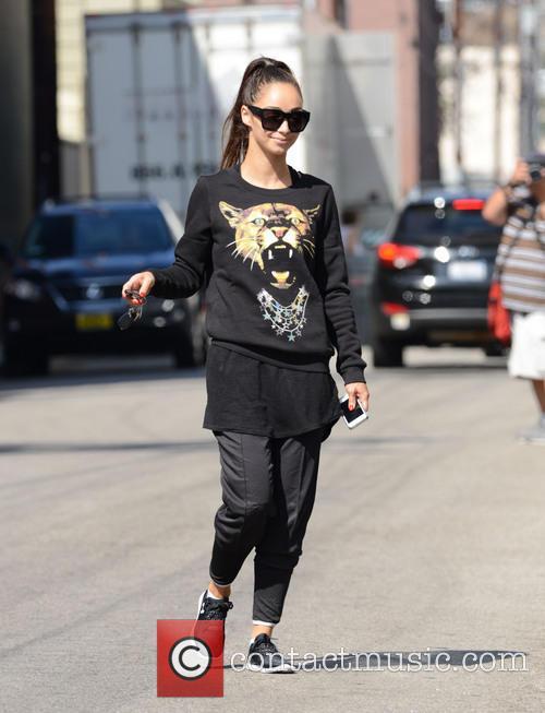 Cara Santana wears a lioness sweatshirt outside her...