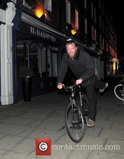 Guy Richie rides home