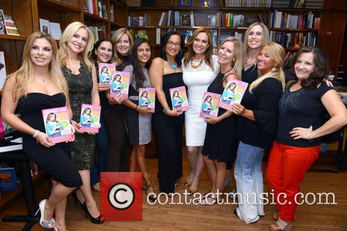 Cecilia Ramirez Harris signs copies of her book...