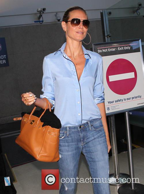 Heidi Klum arrives at Los Angeles International (LAX)...