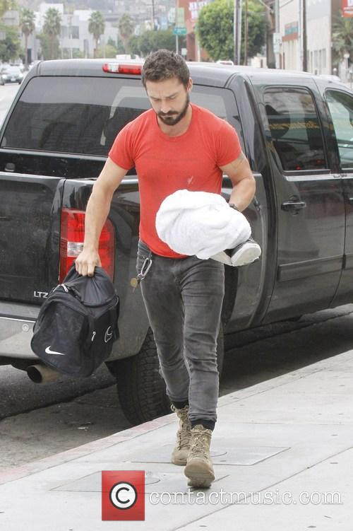 Shia LaBeouf wearing his favourite old red 'Mighty Alpha Superstars 1981-1982' t-shirt