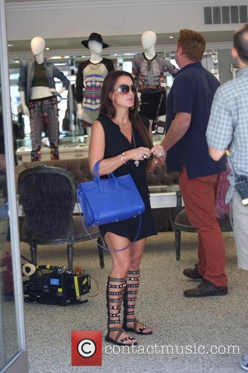 Kyle Richards films her show at her store...