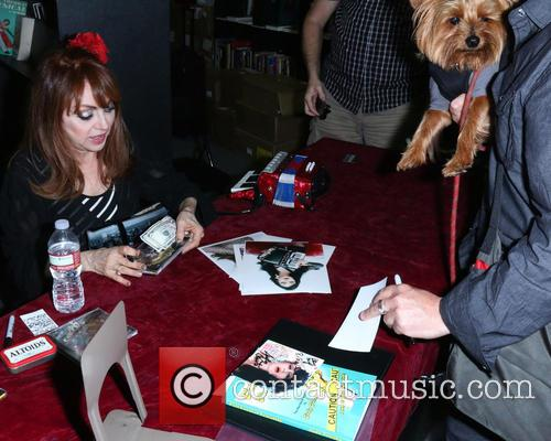 Judy Tenuta signs copies of her new book...