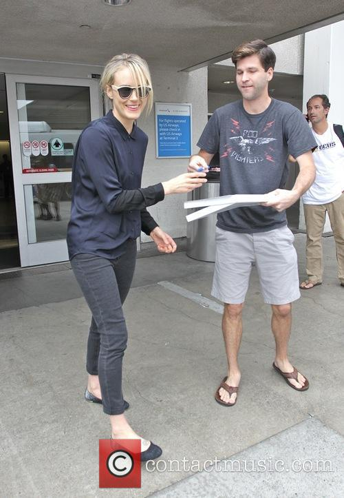 Taylor Schilling arrives at Los Angeles International Airport...