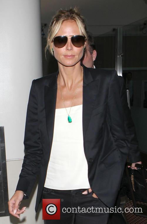 Heidi Klum arrives at Los Angeles International (LAX)...