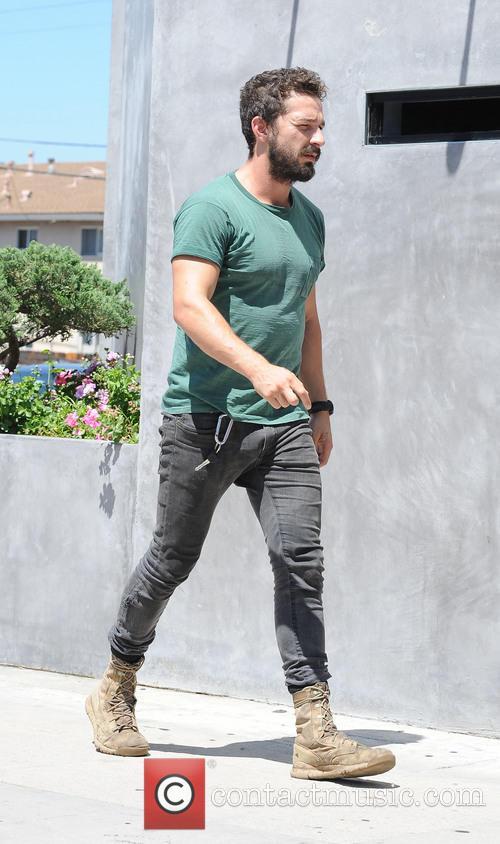 Shia LaBeouf wearing an old plain green t-shirt