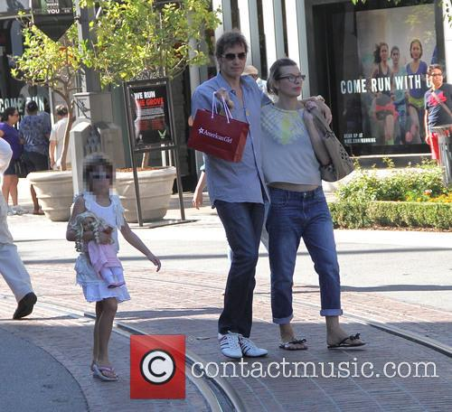 Milla Jovovich and family shopping at The Grove