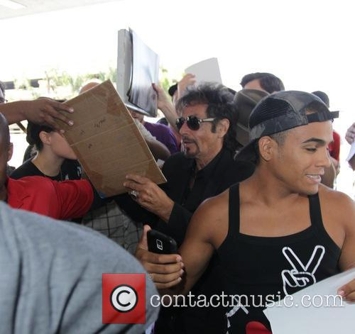 Al Pacino mobbed by fans as he signs...