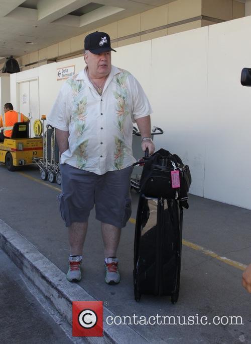 Dennis Haskins arrives at Los Angeles International Airport