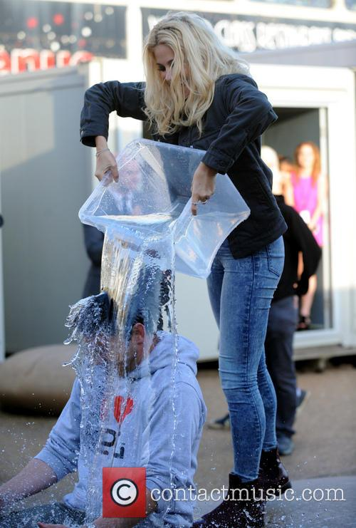 Pixie Lott performs an ice bucket challenge