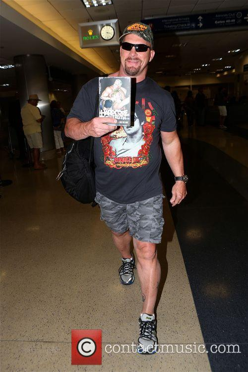 Steve Austin arrives at Los Angeles International (LAX)...