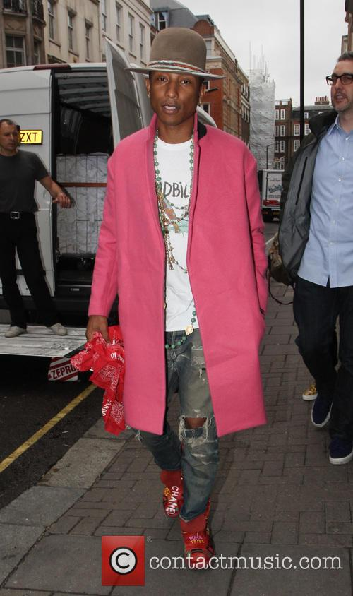 Pharrell Williams arriving at the Dover Street Market
