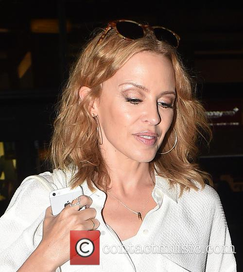 Kylie Minogue at London Heathrow Airport