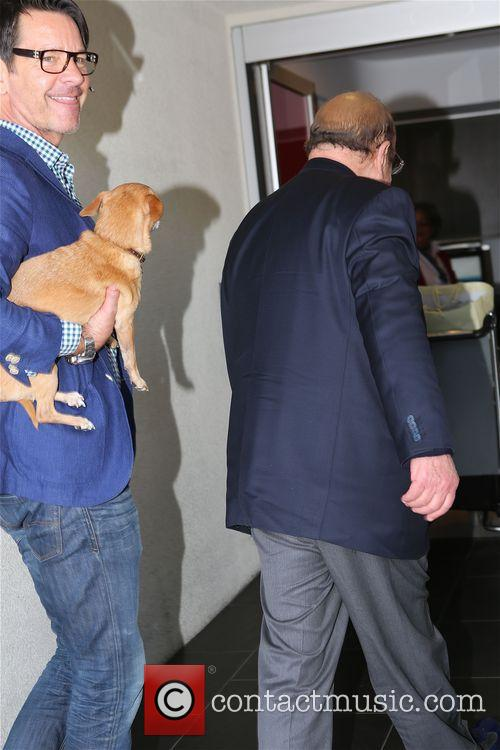 Clive  Davis and his dog  get ready for their flight at LAX