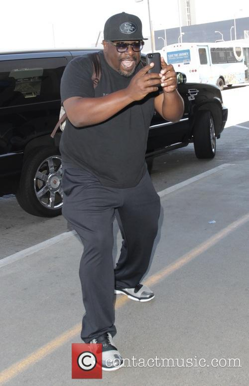 Cedric the Entertainer arrives at Los Angeles International...