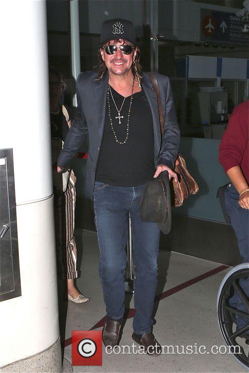 Richie Sambora and his girlfriend Orianthi Panagaris arrive...