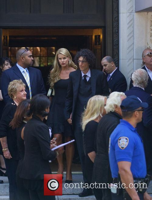 Howard Stern and Beth Ostrosky